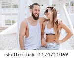 young couple listening music... | Shutterstock . vector #1174711069