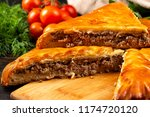 piece of meat pie with greens... | Shutterstock . vector #1174720120