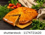 delicious cut meat pie on a... | Shutterstock . vector #1174721620
