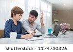 worried couple pay bills online ... | Shutterstock . vector #1174730326