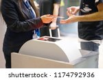 the stewardess checking the... | Shutterstock . vector #1174792936
