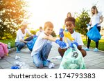 volunteers with garbage bags... | Shutterstock . vector #1174793383