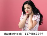 young woman suffering from neck ... | Shutterstock . vector #1174861399