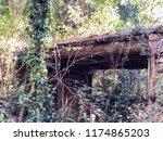 abandoned timber bridge river... | Shutterstock . vector #1174865203