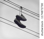Sneakers Hanging On A Telephon...
