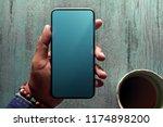 smartphone mockup image. hand... | Shutterstock . vector #1174898200