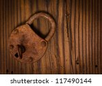 Old Padlock On The Wooden Board