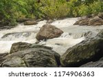 wet stones and white tides in... | Shutterstock . vector #1174906363