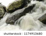 beautiful white tides and stones | Shutterstock . vector #1174913680