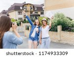 women travelling in a city... | Shutterstock . vector #1174933309