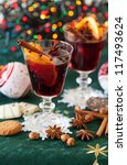 Two glasses of mulled wine with variation of spices - stock photo