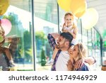 happy family walking along the... | Shutterstock . vector #1174946929