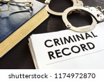 criminal record and handcuffs... | Shutterstock . vector #1174972870