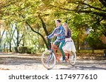 young happy tourist couple ... | Shutterstock . vector #1174977610