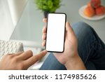 man hand holding phone with... | Shutterstock . vector #1174985626