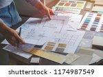 Architect designer Interior creative working hand drawing sketch plan blueprint selection material color samples art tools Design Studio