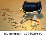 homemade fly for fly fishing.... | Shutterstock . vector #1175029660