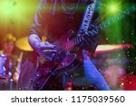 a man is playing guitar on... | Shutterstock . vector #1175039560