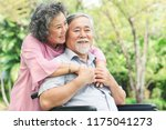 happy elderly couple with... | Shutterstock . vector #1175041273