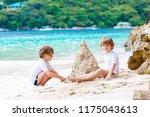 two little kids boys having fun ... | Shutterstock . vector #1175043613