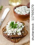 pate of cottage cheese with herbs and chili peppers on a piece o - stock photo