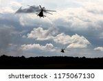 military helicopters fly in the ... | Shutterstock . vector #1175067130