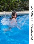 small girl jump in the swimming ... | Shutterstock . vector #1175077243