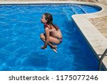 small girl jump in the swimming ... | Shutterstock . vector #1175077246