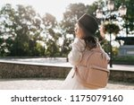 back view of little charming... | Shutterstock . vector #1175079160
