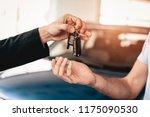 showroom dealer the gives car... | Shutterstock . vector #1175090530