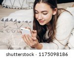beautiful girl lies on the bed... | Shutterstock . vector #1175098186