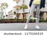 slim girl in gray pants doing... | Shutterstock . vector #1175104519