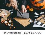 halloween preparation. hands... | Shutterstock . vector #1175127700