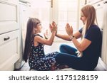 mother with her daughter... | Shutterstock . vector #1175128159