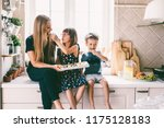 mom with her two children... | Shutterstock . vector #1175128183