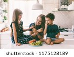 mom with her two children... | Shutterstock . vector #1175128189