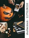 halloween preparation. hands... | Shutterstock . vector #1175128210