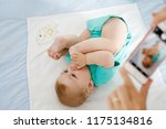 parent taking photo of a baby... | Shutterstock . vector #1175134816
