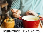 the girl dines in a cozy cafe ... | Shutterstock . vector #1175135296