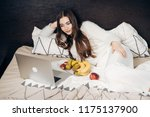 a tired girl with long hair... | Shutterstock . vector #1175137900