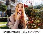beautiful young blonde girl... | Shutterstock . vector #1175143990