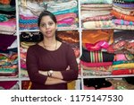 portrait of boutique owner with ... | Shutterstock . vector #1175147530