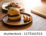 meat burger on wooden plate ... | Shutterstock . vector #1175161513