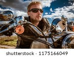biker man wearing a leather... | Shutterstock . vector #1175166049