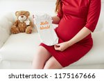 Pregnant Woman In Red Dress...