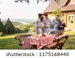 group of friends making... | Shutterstock . vector #1175168440