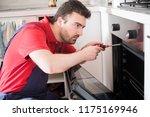 professional worker repairing... | Shutterstock . vector #1175169946