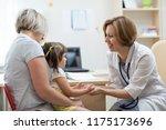 little child girl with her...   Shutterstock . vector #1175173696