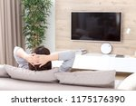 young woman watching tv in the... | Shutterstock . vector #1175176390
