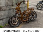 Rusty Motorcycle At The...